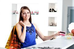 woman at shopping checkout paying credit card - stock photo
