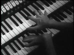 High angle view of woman playing pipe organ, 1960s Stock Footage