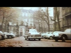Peugeot parking in front of  building in Paris, 1960s - stock footage