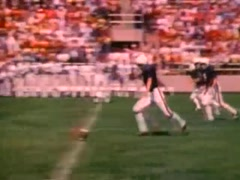 Kick off at high school football game, 1980s Stock Footage