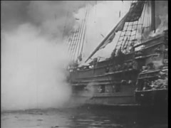 17th century reenactment of ship blowing up during battle at sea Stock Footage