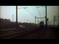 Electric train passing through rural area, 1960s - stock footage