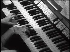 High angle view of woman playing pipe organ in church, 1960s Stock Footage