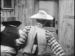 Two cowboys dragging man into sheriff's office, 1940s Arkistovideo