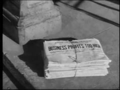 Bundle of newspapers dropped on sidewalk, 1950s Stock Footage