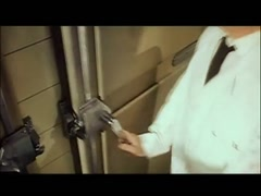 Worker pulling open mortuary refrigerator door, 1960s Stock Footage