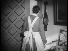 Rear view of maid opening door, 1930s Stock Footage