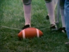 Low section of referee measuring yard line on football field, 1980s - stock footage