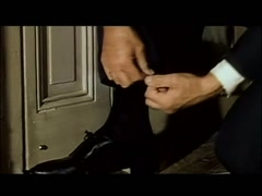Man creating string trap at bottom of door, 1960s - stock footage