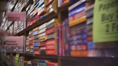 Romance Books in Large Bookshelves with Shallow Depth of Field Stock Footage