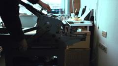 Making a print on a vintage letterpress machine Stock Footage