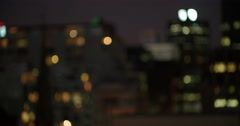 Defocused view of citylights at night - stock footage