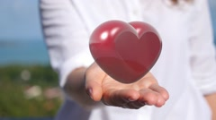 Heart in Female Hands Stock Footage