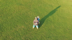 Aerial view from green lawn to suburban neighborhood. Out-of-town real estate Stock Footage