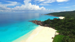 Aerial view of Grand Anse (beach) on La Digue Island, Seychelles. Stock Footage