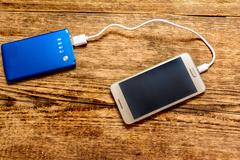 Mobile phone charging Stock Photos