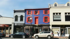 Blue Row House with Red Shutters in City Wide, 4K Stock Footage