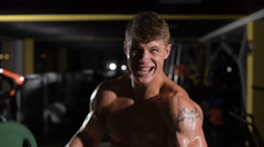 the last effort. of possibilities. Young adult bodybuilder doing weight lifting - stock footage