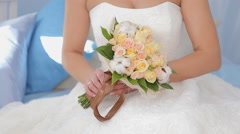 The Bride holds a wedding bouquet - stock footage