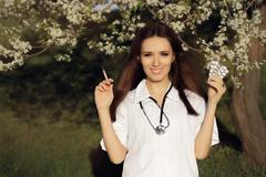 Spring Female Doctor with  Vaccine Syringe and Pills Stock Photos