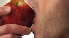 Closeup of a unshaven man eating an apple - stock footage