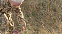 young girl collects reeds on a winter day.The child in the reeds, cane. - stock footage