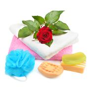 Towels, soap and sponges isolated on white background Stock Photos