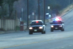 Two Police Cars Enroute Stock Footage