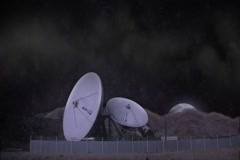 Satilite Uplink Dishes and Moon Stock Footage