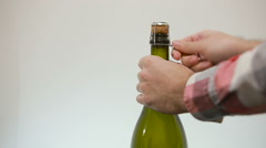 Man hand opening champagne bottle - stock footage