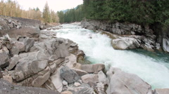Highway 2 by Raging Skykomish River at Eagles Falls Stock Footage