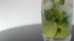 pouring soda in mojito on white background - stock footage