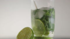 Mojito cocktail on white background Stock Footage