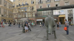 Tourists taking pictures near Monumental Break on Graben, Vienna Stock Footage