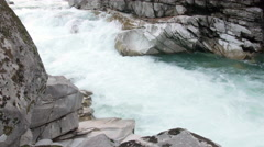 Pan Across Rock Boulders to Raging Skykomish River at Eagles Falls Stock Footage