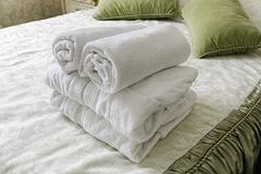 Towel in Hotel bedoom. Welcome guests room service - stock photo
