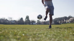 4K Unseen soccer player doing kick ups in the park Stock Footage