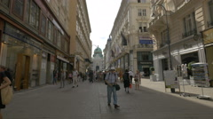 Tourists and locals walking on Kohlmarkt in Vienna Stock Footage