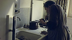 Austria 1966: old woman cooking potatoes Stock Footage