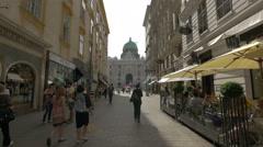 Tourists walking on Kohlmarkt, near Michaelerplatz in Vienna Stock Footage