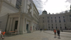 Walking and driving in front of St. Michael's Church in Vienna Stock Footage
