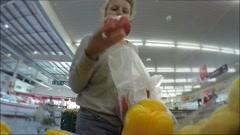 Woman in Supermarket Choosing Vegetables. 4K Stock Footage