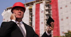 Financial Investor Inspect Construction Stage Steps Talking Phone Using Tablet Stock Footage
