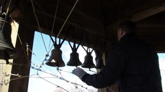 Ring of Bells on the wooden belfry. PAN. Stock Footage