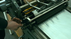 Caucasian male preparing a vintage letterpress machine for printing Stock Footage