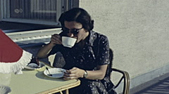 Austria 1965: woman having a coffe at home Stock Footage