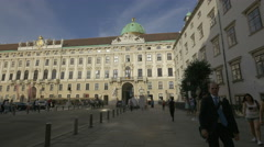 People walking in a small square near the Hofburg Palace, Vienna Stock Footage
