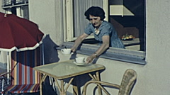 Austria 1965: woman serving coffe outdoor - stock footage