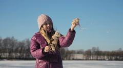 Girl holding brown cattail - stock footage