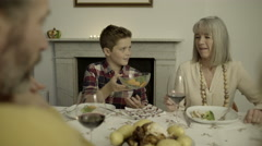 Multi generation family together for meal at home - stock footage